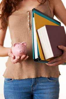 Female Student Holding Textbooks, Files And Piggy Bank